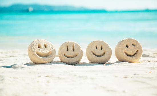 Smiley faces in the sand