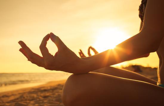 Enjoy early morning yoga on the beach.