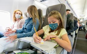 Family traveling on busy plane.