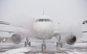 Ground crew deicing aircraft