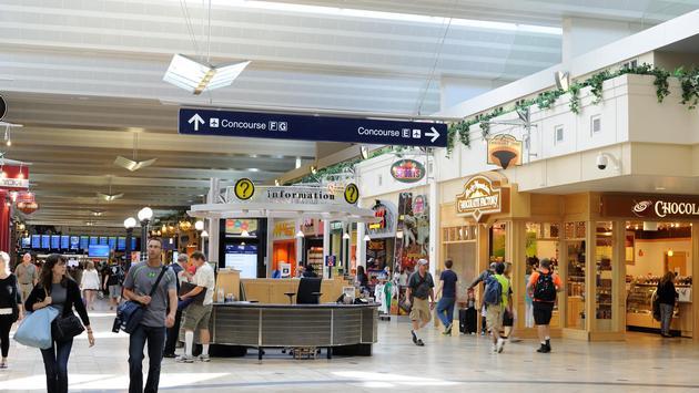 Passengers walking by shops at Minneapolis-St Paul International Airport