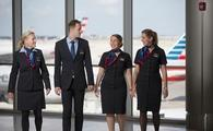 Flight attendants at the gate about to board an American Airlines flight