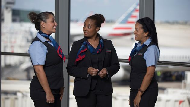 American Airlines gate agents conversing at the gate