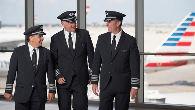 American Airlines pilots conversing at the gate