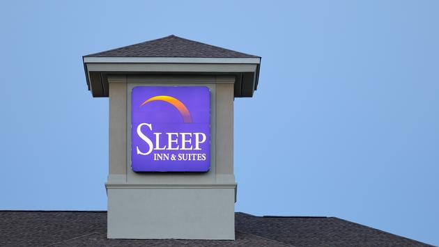 Sleep Inn & Suites sign at dusk