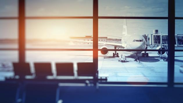 airplane waiting for departure in airport terminal