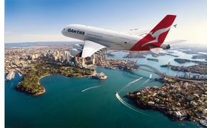 Qantas Airbus 380 jet over Sydney Harbor