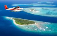 Seaplane flying above the Maldives