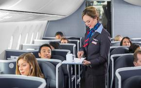 Flight attendant serving coffee aboard an American Airlines flight