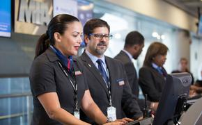 American Airlines gate agents at the counter