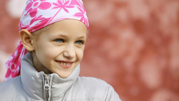 Girl with hair loss from fighting childhood cancer.