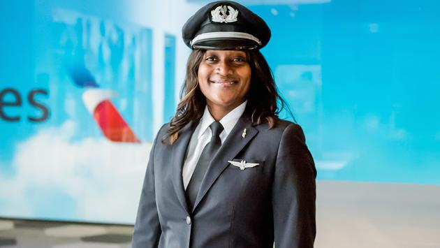 Female American Airlines pilot with logo background