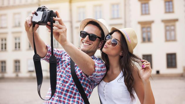 Happy tourists taking a selfie