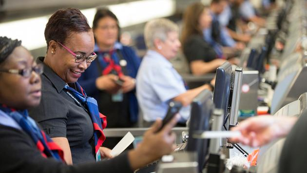 American Airlines ticketing agents verifying customer information