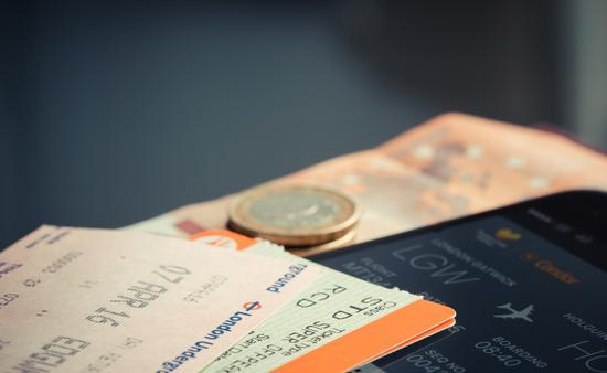 Travel documents and smart phone with flight information