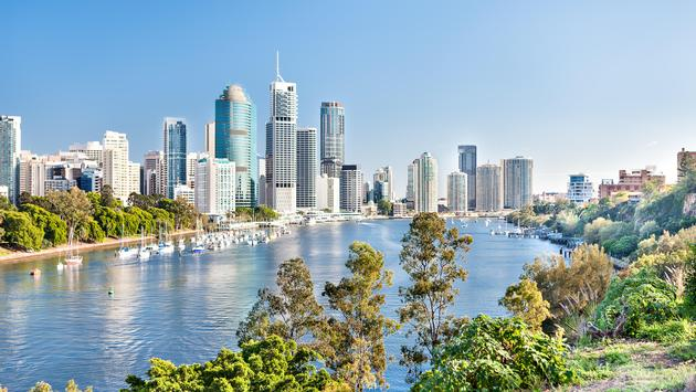 Blue water river surrounded by trees in Brisbane City