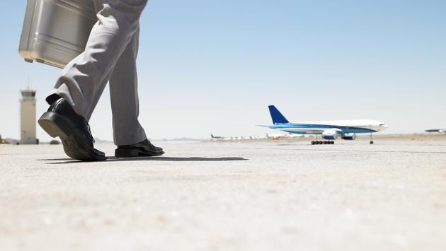 A man walking toward an airplane