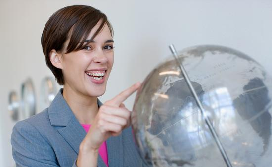 young travel agent smiling globe