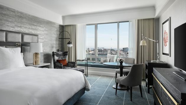 Four Seasons Hotel Guest Room with city view and greens and grays