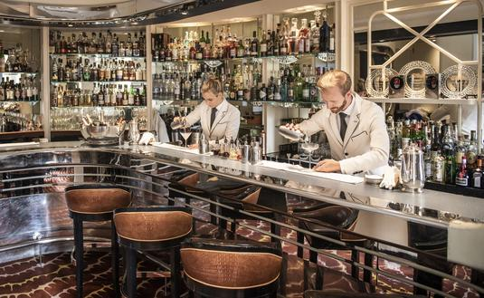 Art deco bar with bartenders pouring martinis