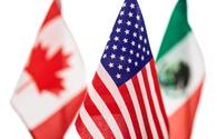 Flags of U.S., Canada and Mexico.