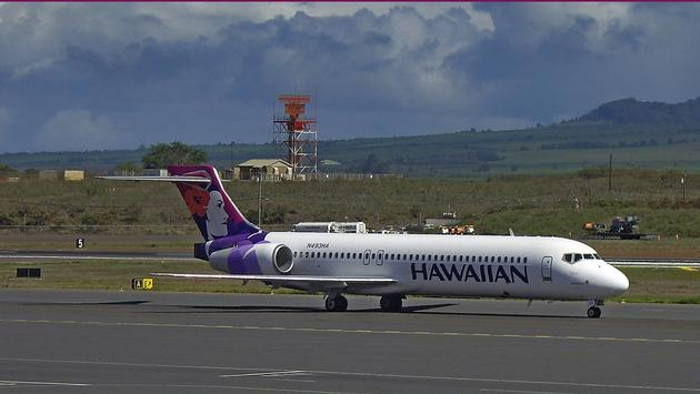 Hawaiian Airlines plane on runway at Kahului Airport in Maui