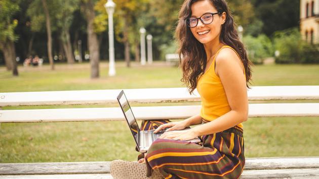 International student on a laptop.