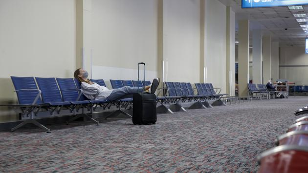 Woman waiting at empty airport.