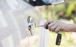 Woman unlocking a rental car