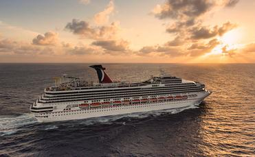A sunlit Carnival Sunshine steaming to her next port-of-call