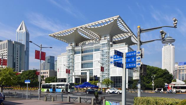 The Shanghai Grand Theatre (left) and the Radisson Blu Hotel Shanghai New World (right)