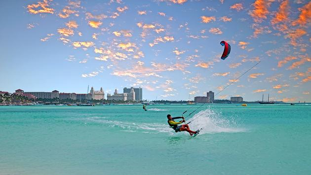 PHOTO: Water sport at Palm Beach on Aruba island at sunset (photo via Nisangha / iStock / Getty Images Plus)