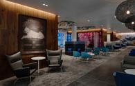 Airport lounge with eclectic modern furnishings in bold colors