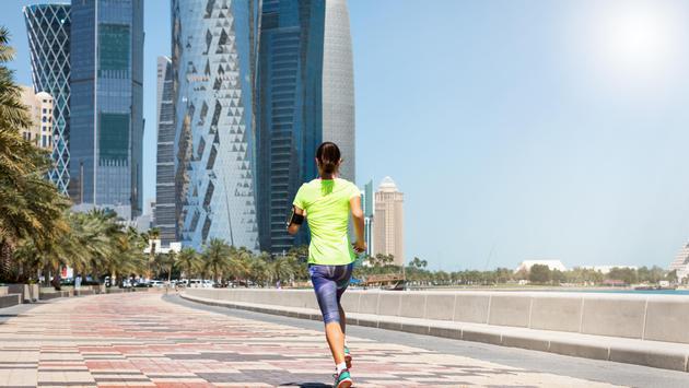 Female runner jogs through Doha, Qatar