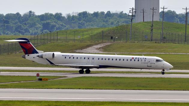 Delta airplane on runway at Cincinnati/Northern Kentucky International Airport in Kentucky