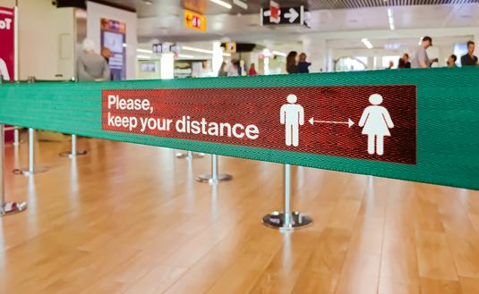 Social distance sign at airport