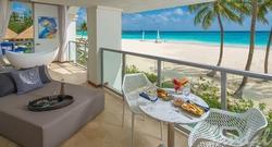 Get up to $1,000 Instant Credit: Beachfront One Bedroom Butler Suite w/ Balcony Tranquility Soaking Tub
