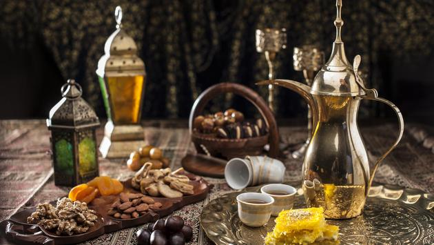 Traditional Arabian coffee, nuts and sweets.