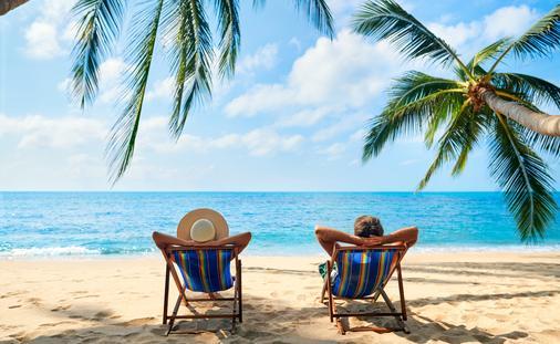 Couple relaxing on an island beach