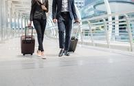 Travelers walking together with luggage