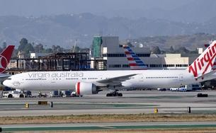 An Australian woman caused a disturbance on a Virgin Australia Boeing 777, similar to this one on the tarmac at LAX, while enroute from Brisbane to Los Angeles.