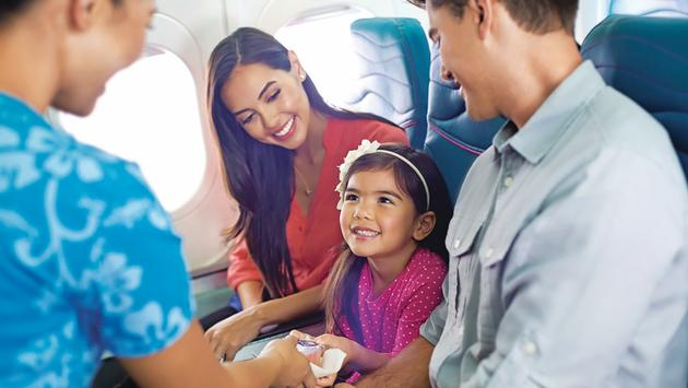Flight Attendant and Family (Photo via Hawaian Airlines)
