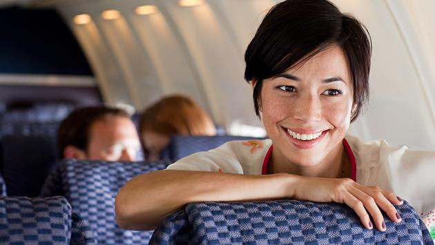 Young woman on an airplane (Photo via Image Source / iStock / Getty Images Plus)