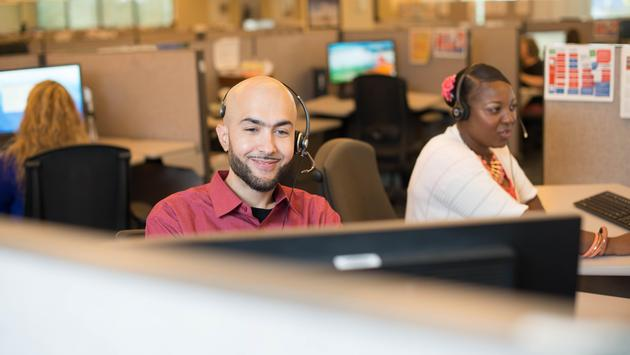Reservation Agents taking customer call (Photo via American Airlines)