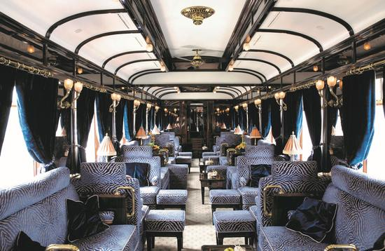 Blue upholstered furnishings on the bar car of the Orient Express.