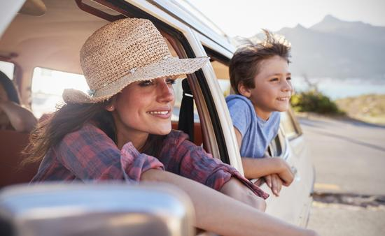 Mother And Children Relaxing In Car During Road Trip (Photo via monkeybusinessimages / iStock / Getty Images Plus)