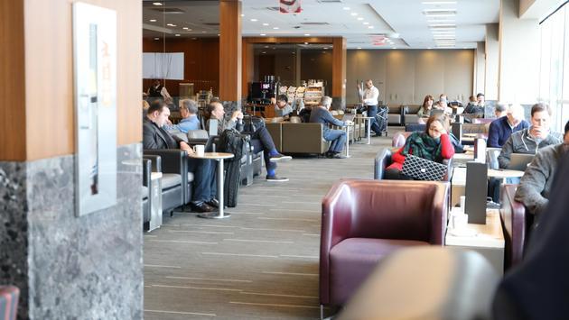Passengers await their flights at LaGuardia Airport