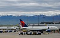 Two Delta Air Lines planes at Salt Lake City International Airport