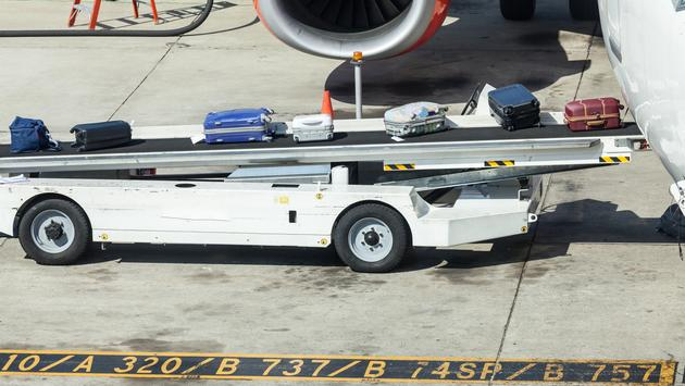 Luggage being loaded onto an airplane