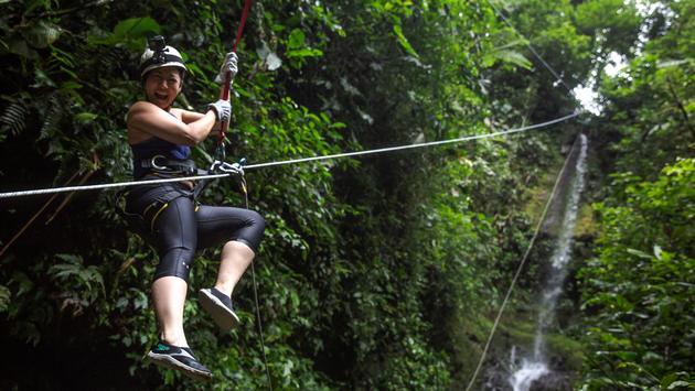 Woman canyoneering in La Fortuna, Costa Rica